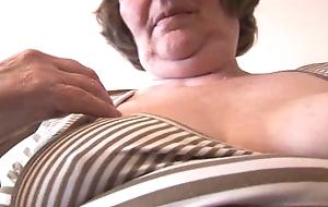 Crestfallen hairy granny in mini skirt