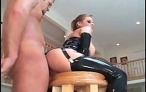 Busty fair-haired in latex stockings and a corset