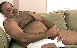 Corpulent daddy plays with his dick