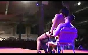 Stripper on stage teasing man