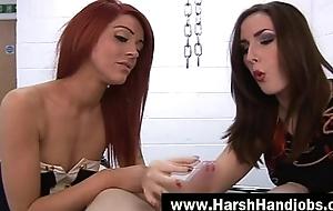 Two angry babes give harsh handjob