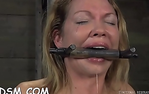 Gagged newborn acquires her racks bounded coupled with clamped