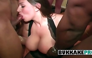 Hot woman is put in an appearance interracial bukkake with 7 men while someone takes pictures