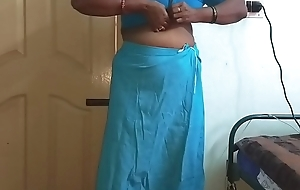 Wearing Saree ready for party