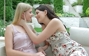 Two beautiful starlets kissing and licking into the open air
