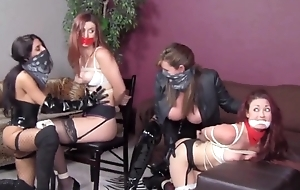 Pair of dominant women carrying-on relative to their bound slave angels