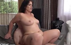 Slightly chubby MILF with sincere boobs fucks juvenile boy