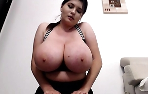 Curvaceous brunette flashes her massive boobs in the sky livecam